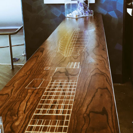 Engraved Stained Ash Community Table | Custom Wood Furniture | Wood From The Hood | Caribou Coffee | Minneapolis
