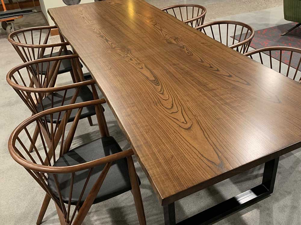 Walnut Stained Book Matched Ash Table Top With Stain Steel Base - Atmosphere Commercial Interiors
